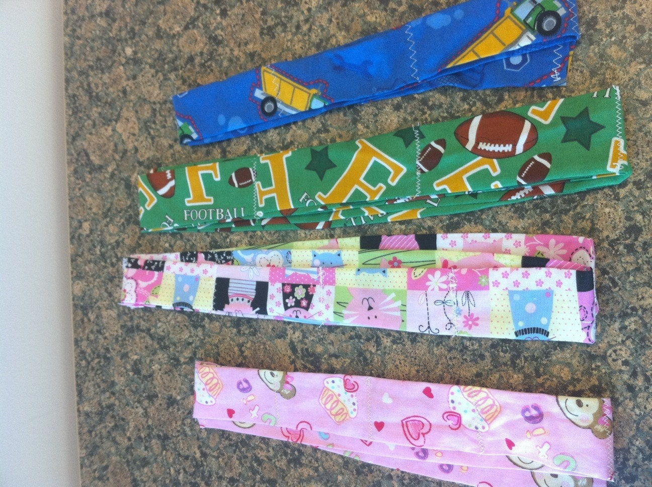 Family Pack cool neck bands 4 cooling neck ties football, cats, trucks, and monkeys and cupcakes