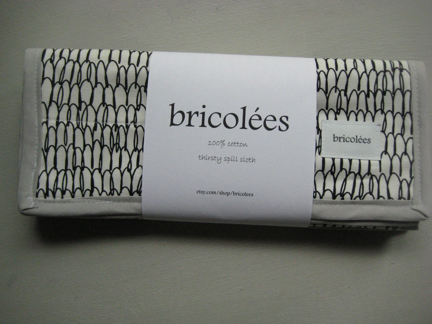 floralicious thirsty spill cloth in gender neutral black and white with gray binding - the modern burp cloth