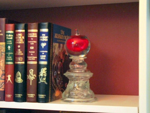 "Book end. Paper weight.  ""The Mighty Apple"" is assembled sculpture made with repurposed glass."