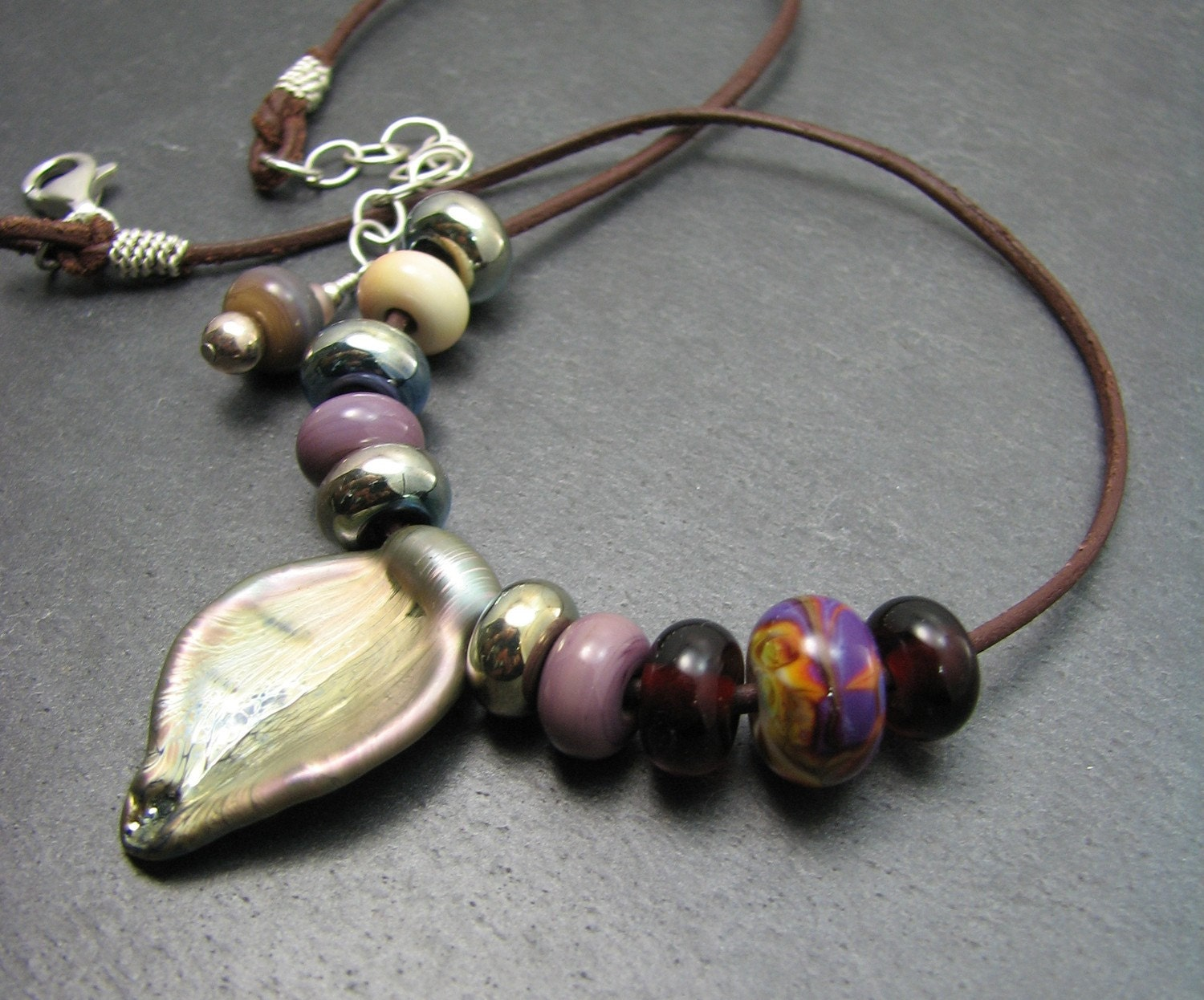 Bountiful metallic shine artisan lampwork and leather necklace