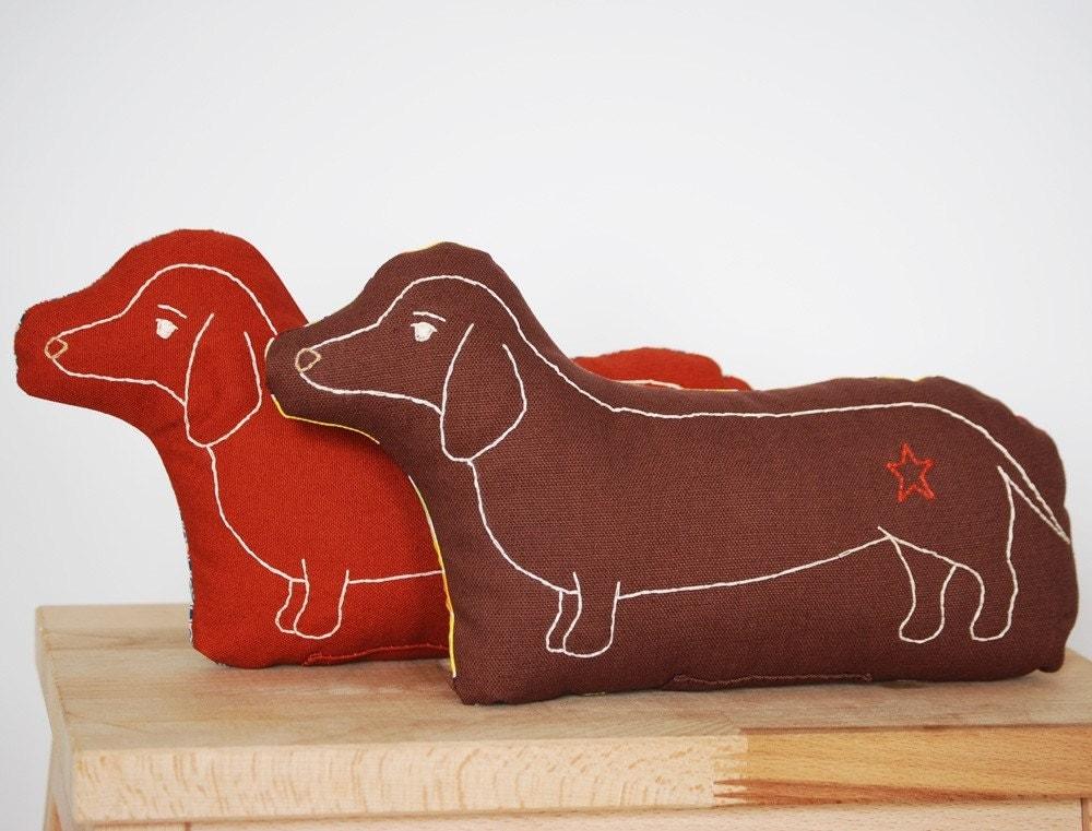 dachshund pillow in burnt orange