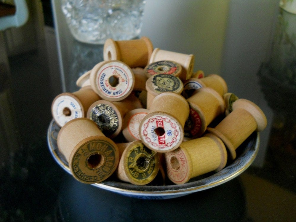 Vintage Bowl of Wooden Thread Spools 12
