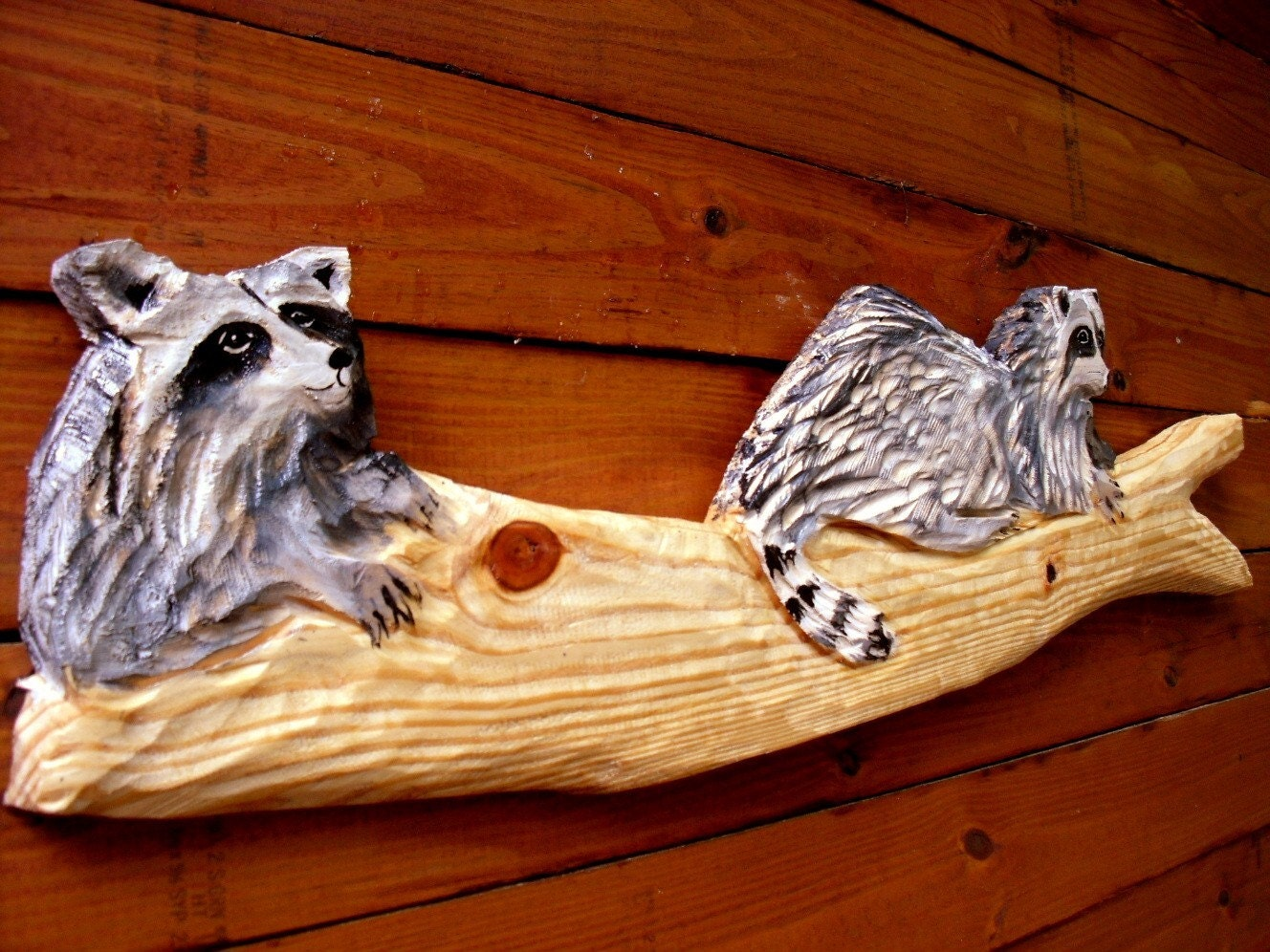 Raccoons on log sculpture ft chainsaw wood carving