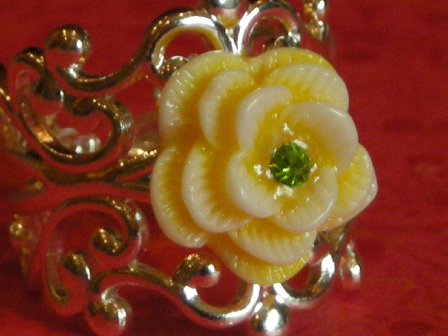 Silver scroll ring with buttery yellow rose