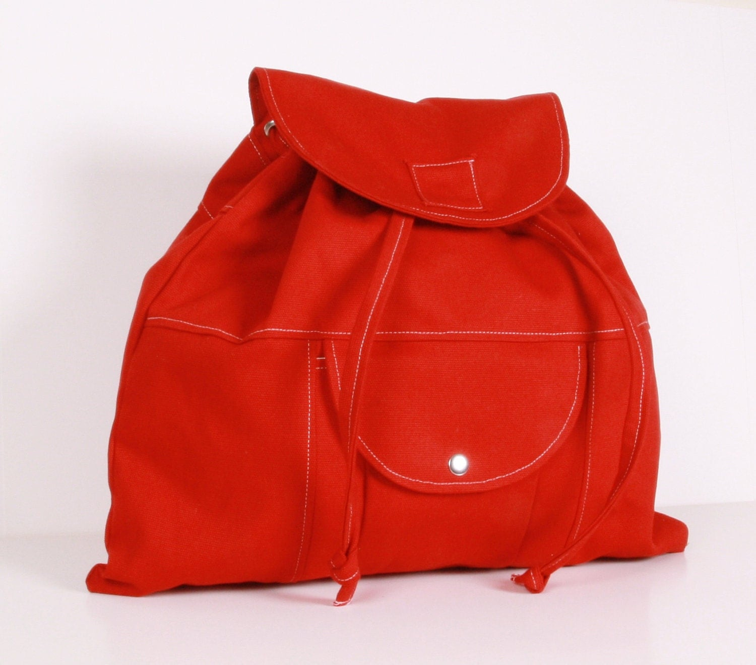 BACKPACK ...Red , canvas with  Cream lining ,adjustable straps
