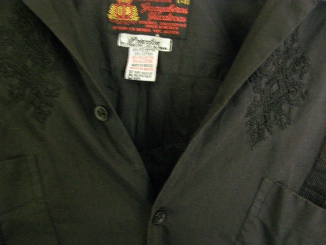 vintage men's black button up shirt with antique doll eye pin and embroidery