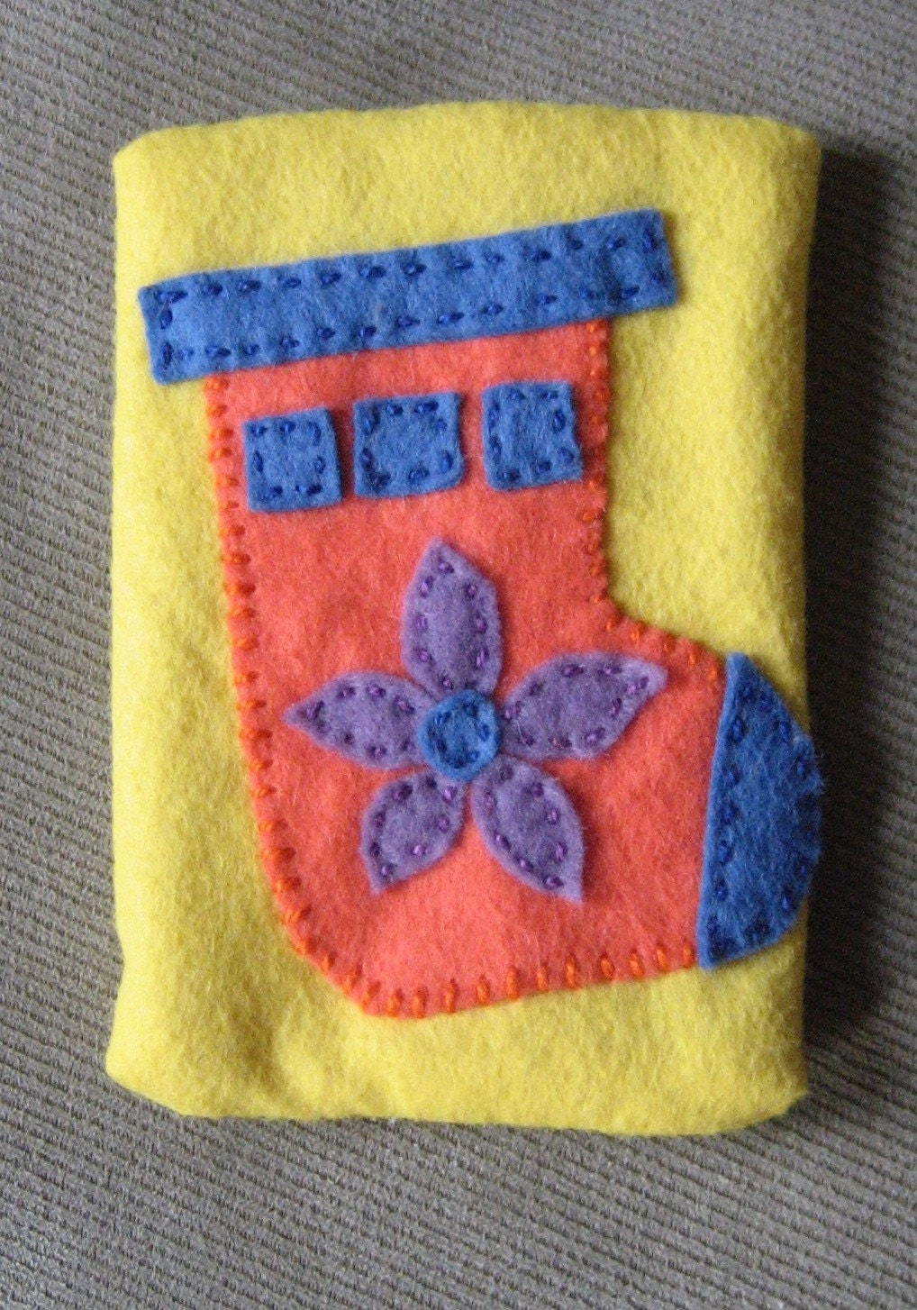 Orange Stocking on Yellow Tissue Cozy