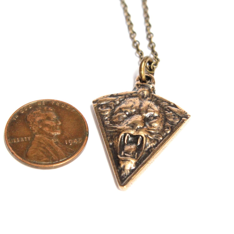 Triangular solid bronze roaring lion pendant from Moon Raven Designs.
