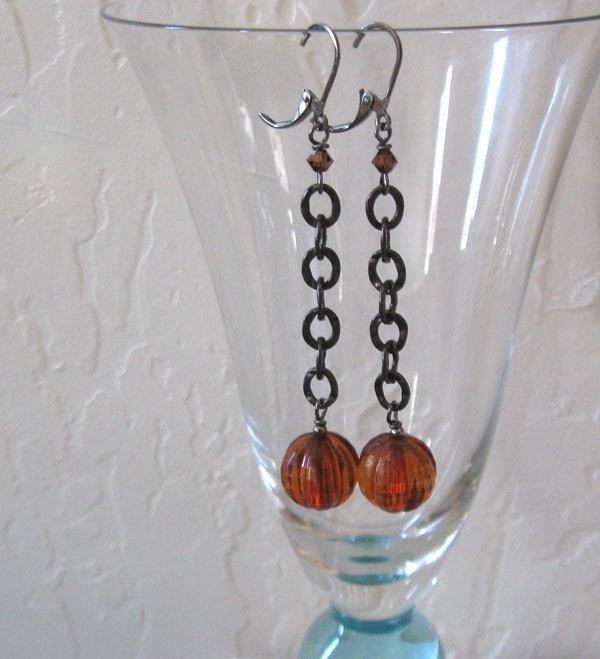 pumpkin shaped beads in transparent dark amberorange lucite