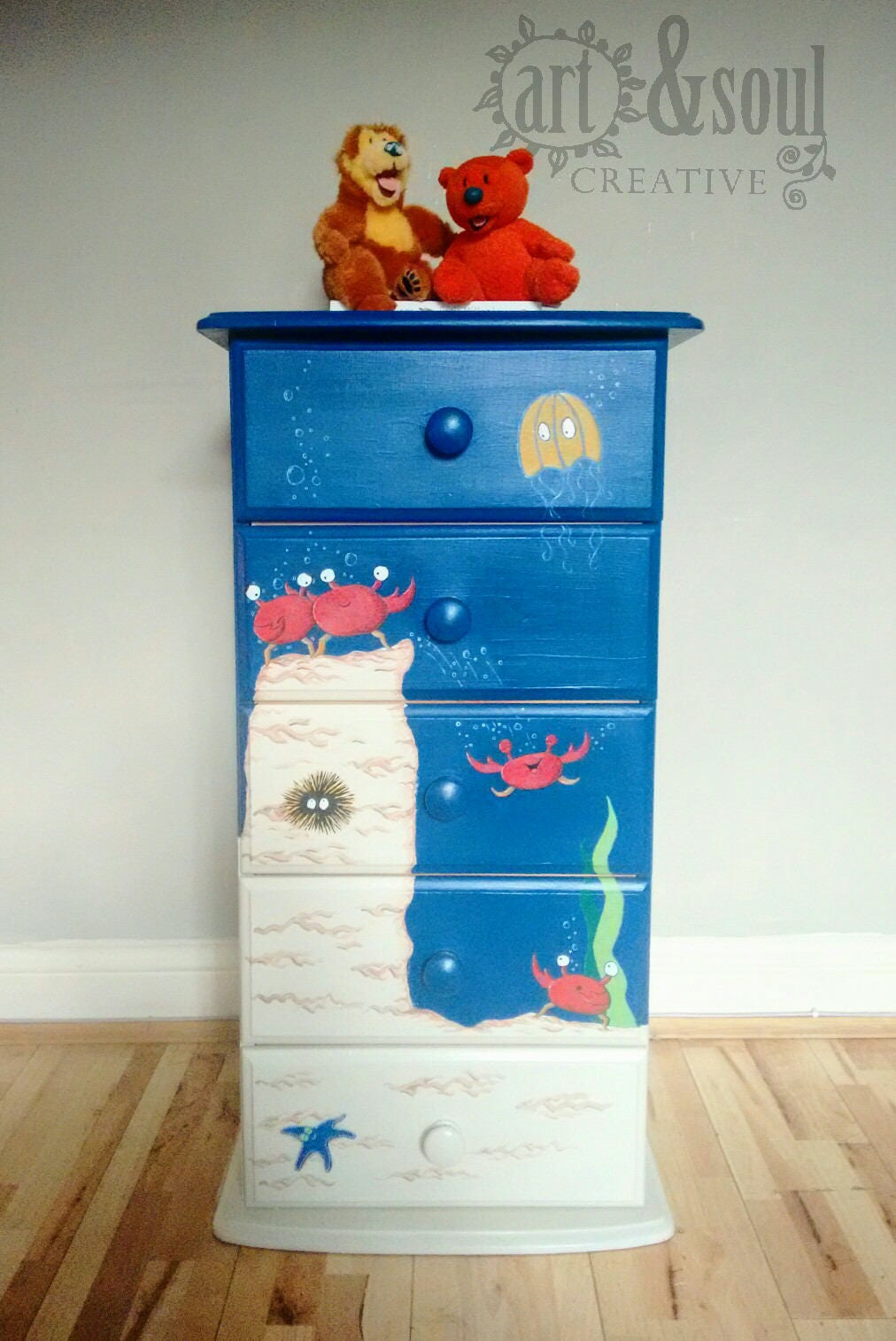 Bespoke kids bedroom drawers hand painted with an under the sea mural