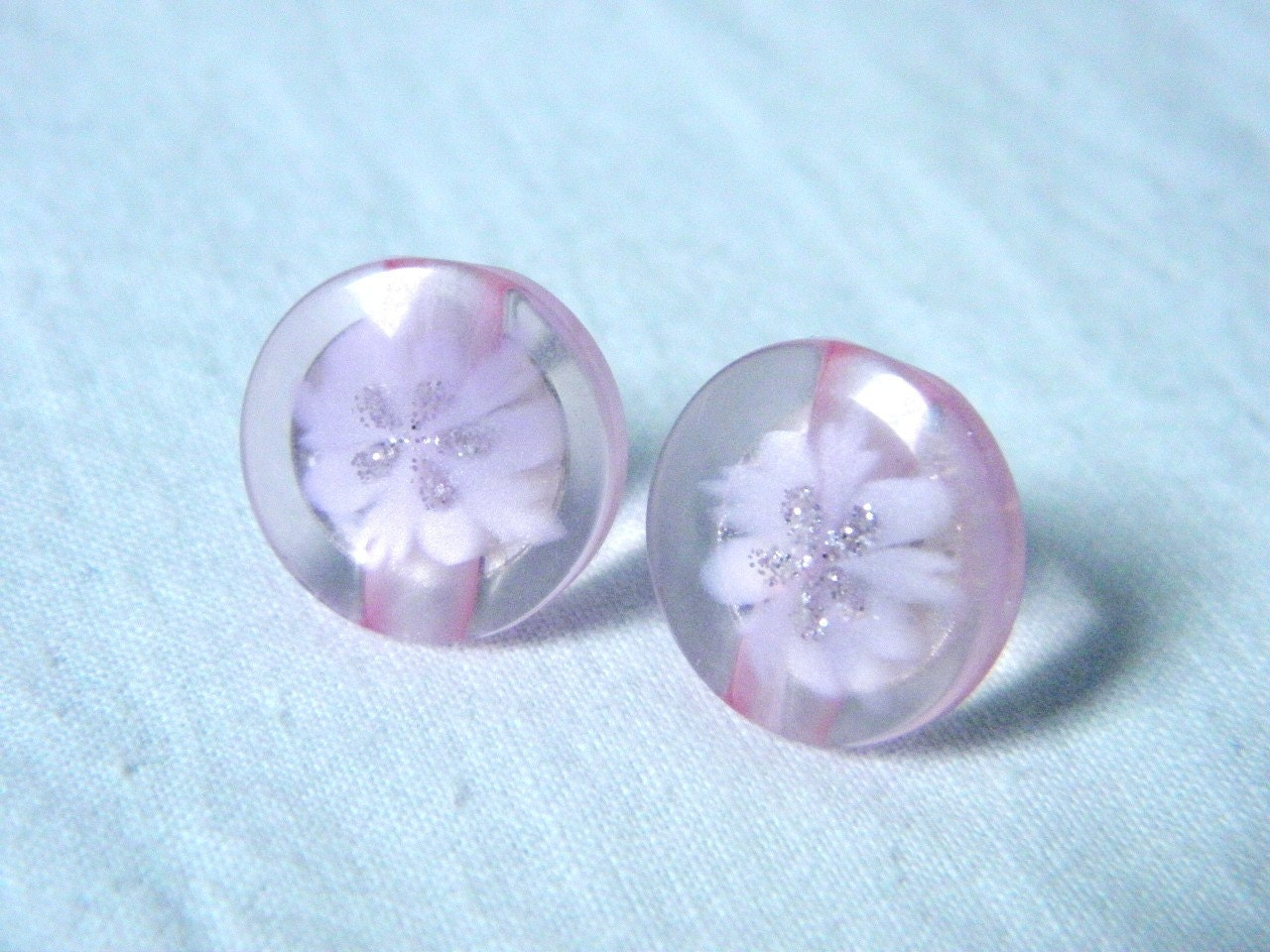 Plastic button earrings pink color