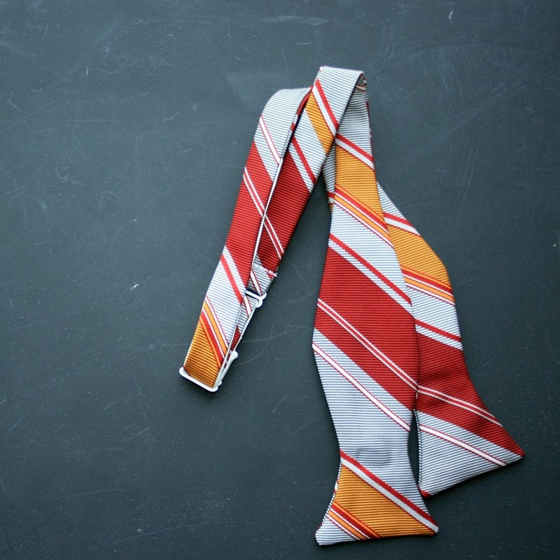 red, yellow, and gray striped bow tie