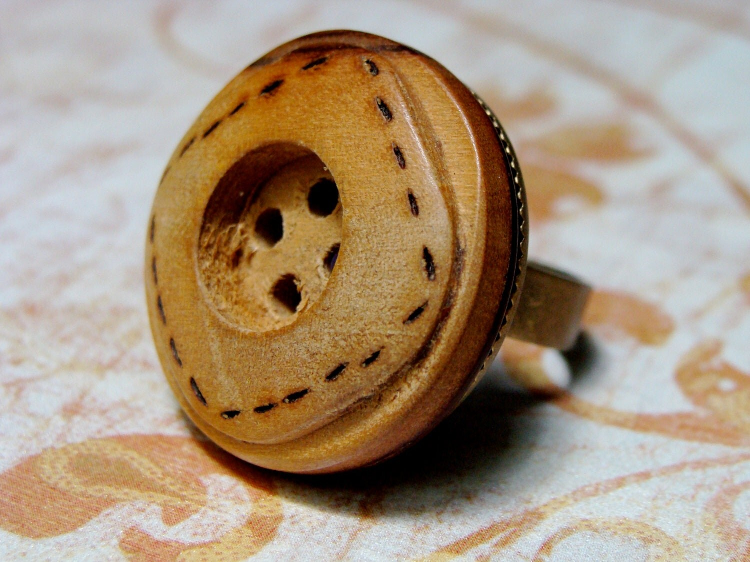 burned stitch marks on wooden button jewelry for fall accessory
