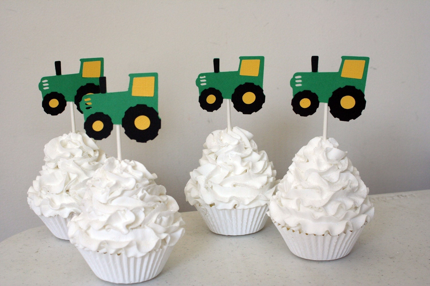 It is a graphic of Selective John Deere Cupcake Toppers