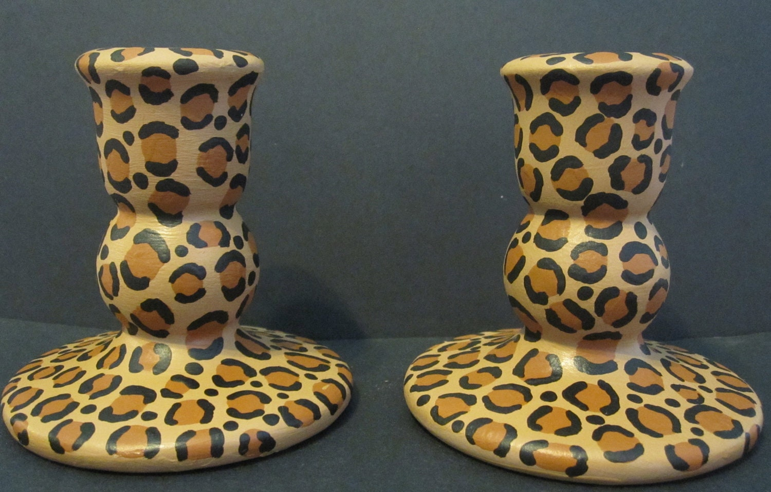 For the room that needs that exotic touch, this set of animal print candle holders is just the thing. Made of glazed ceramic, these make great accents! My Account.