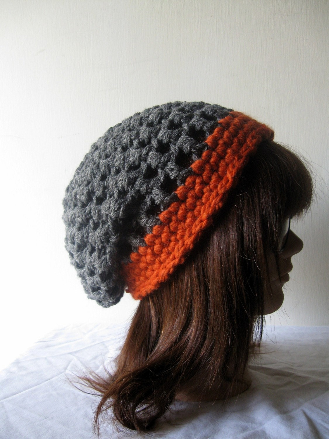 the slacker beanie hat in pumpkin and gray.