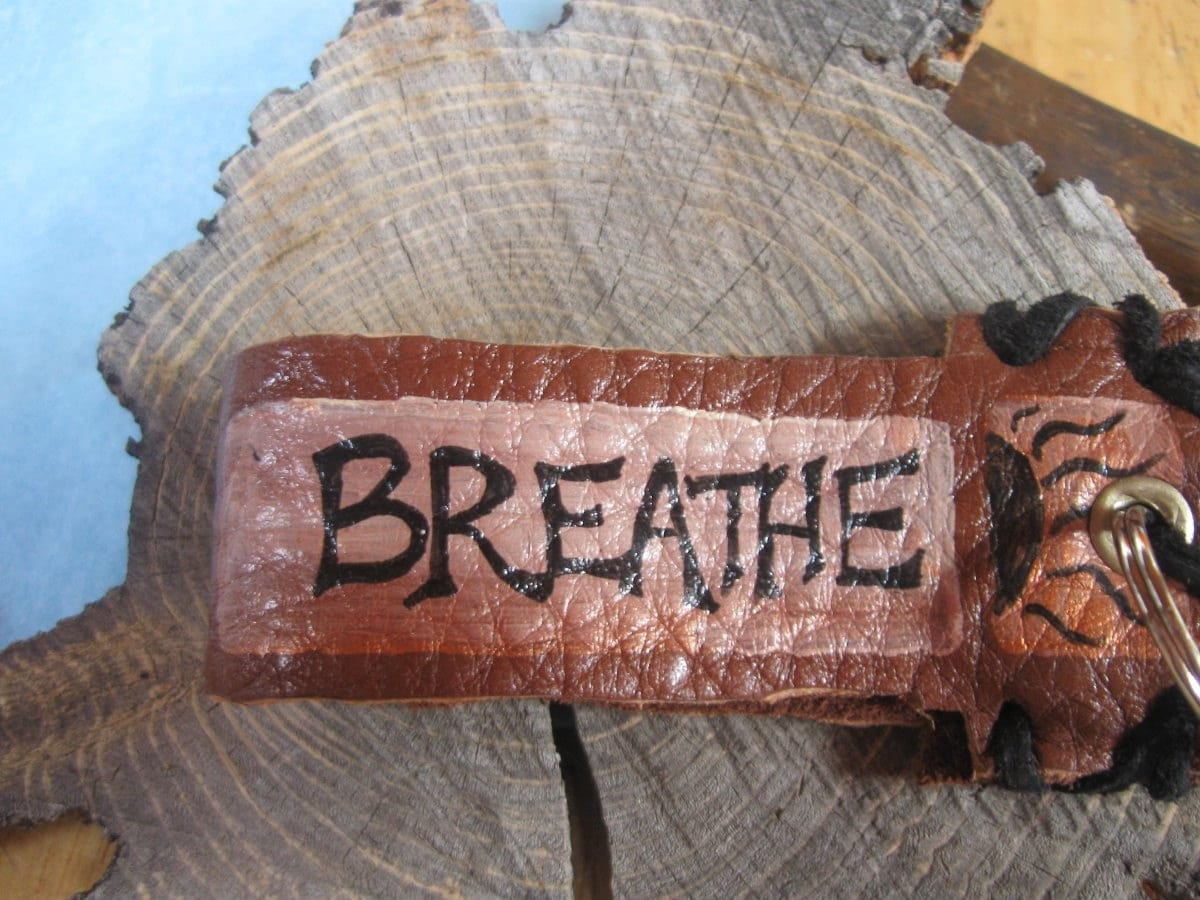 Breathe  handpainted leather keychain by littlewisdoms on Etsy from etsy.com