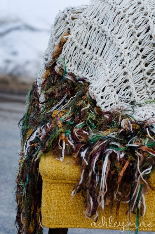 afghan throw blanket outdoor in snow on yellow chair