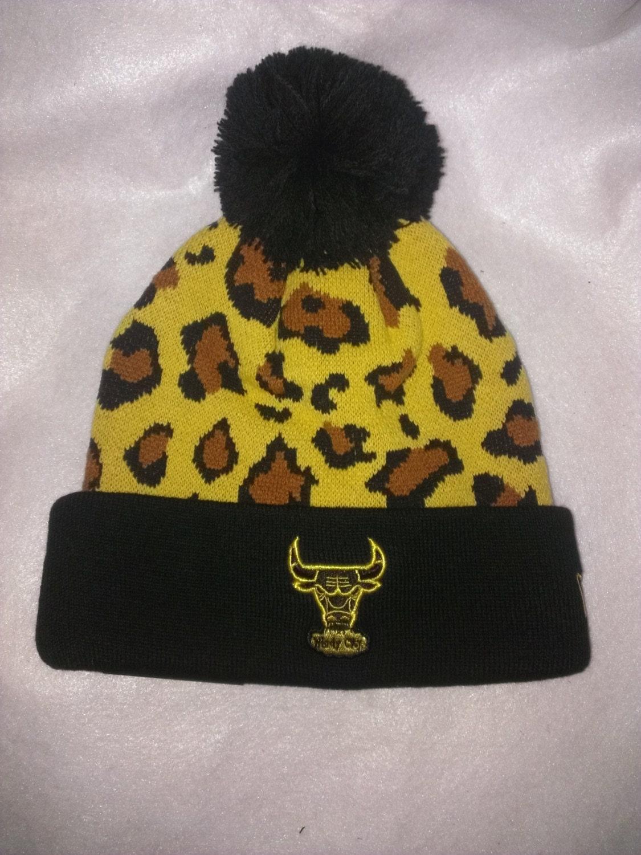 Items similar to chicago bulls gold leopard print knit pom beanie on