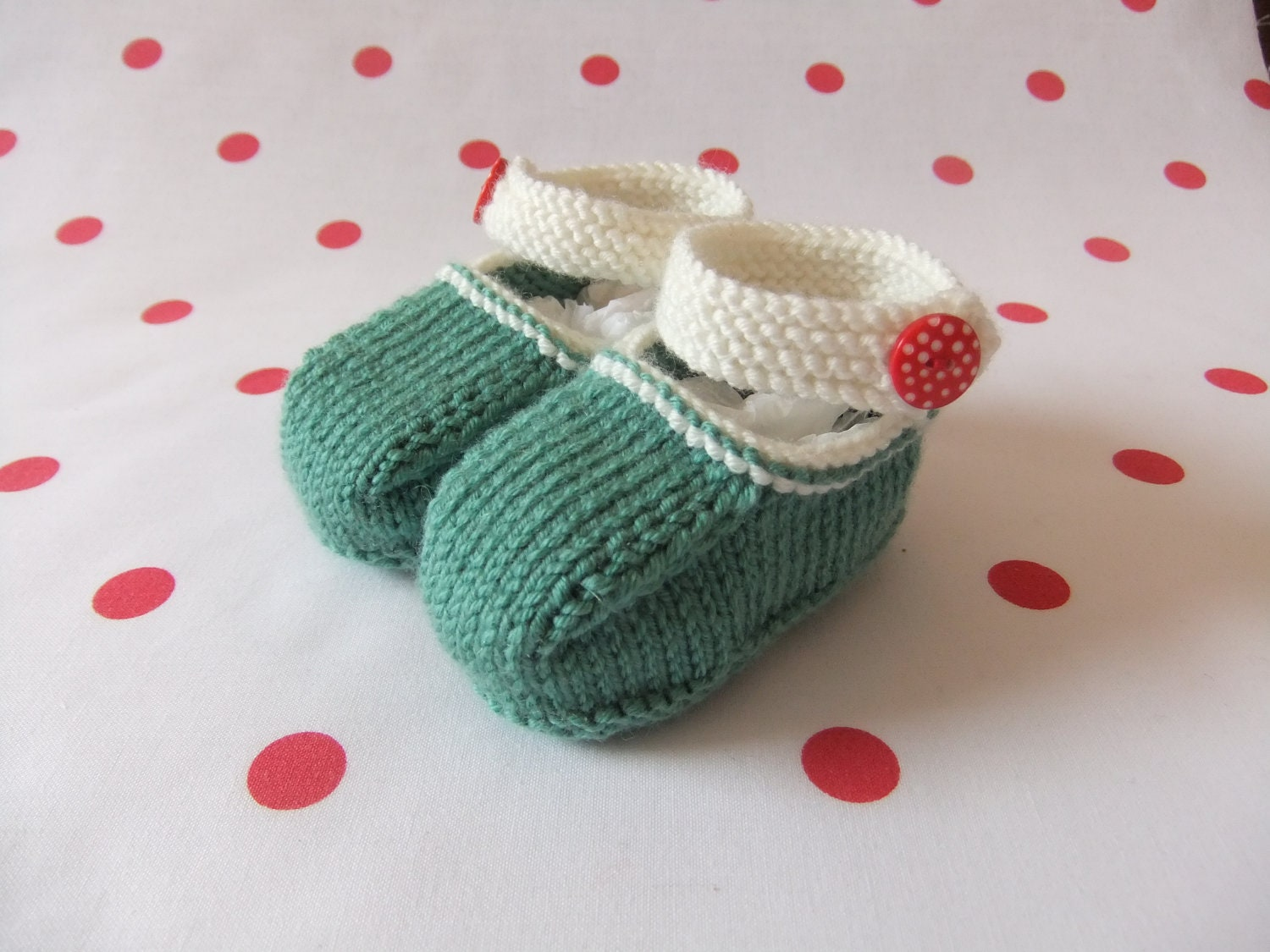 Hand knitted green and cream Mary Jane baby shoes  Available to order in sizes 03 36 and 69 months
