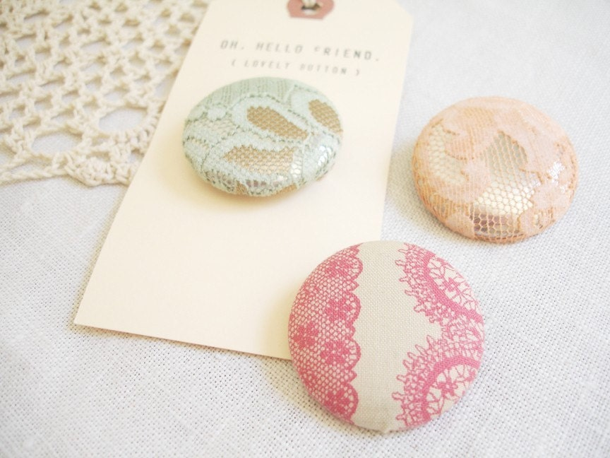 by necessity - lace pinback button badges.