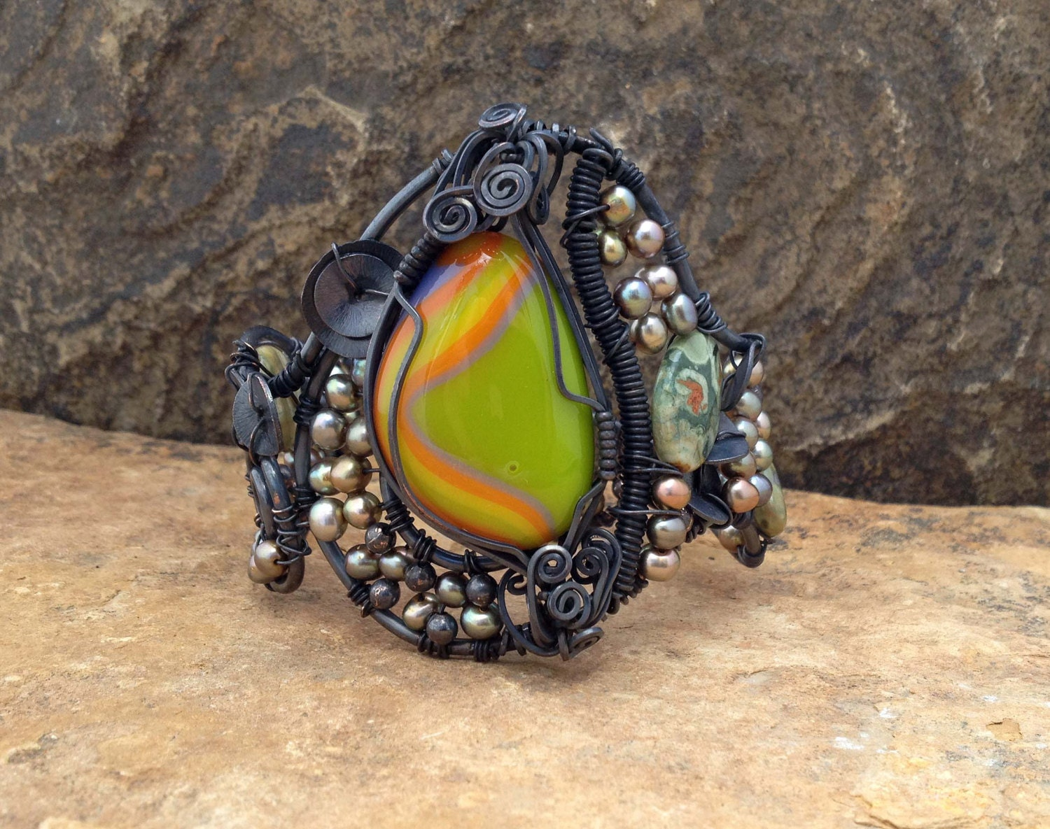 Unique one of a kind wire wrapped oxidized copper cuff bracelet with a beautiful green,orange, yellow and lavender fused glass cabochon - silverlv