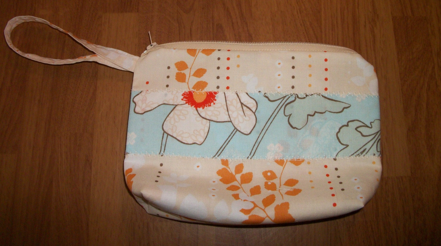 Becca Wristlet / Make-up Bag - Cream with Aqua Floral Accent