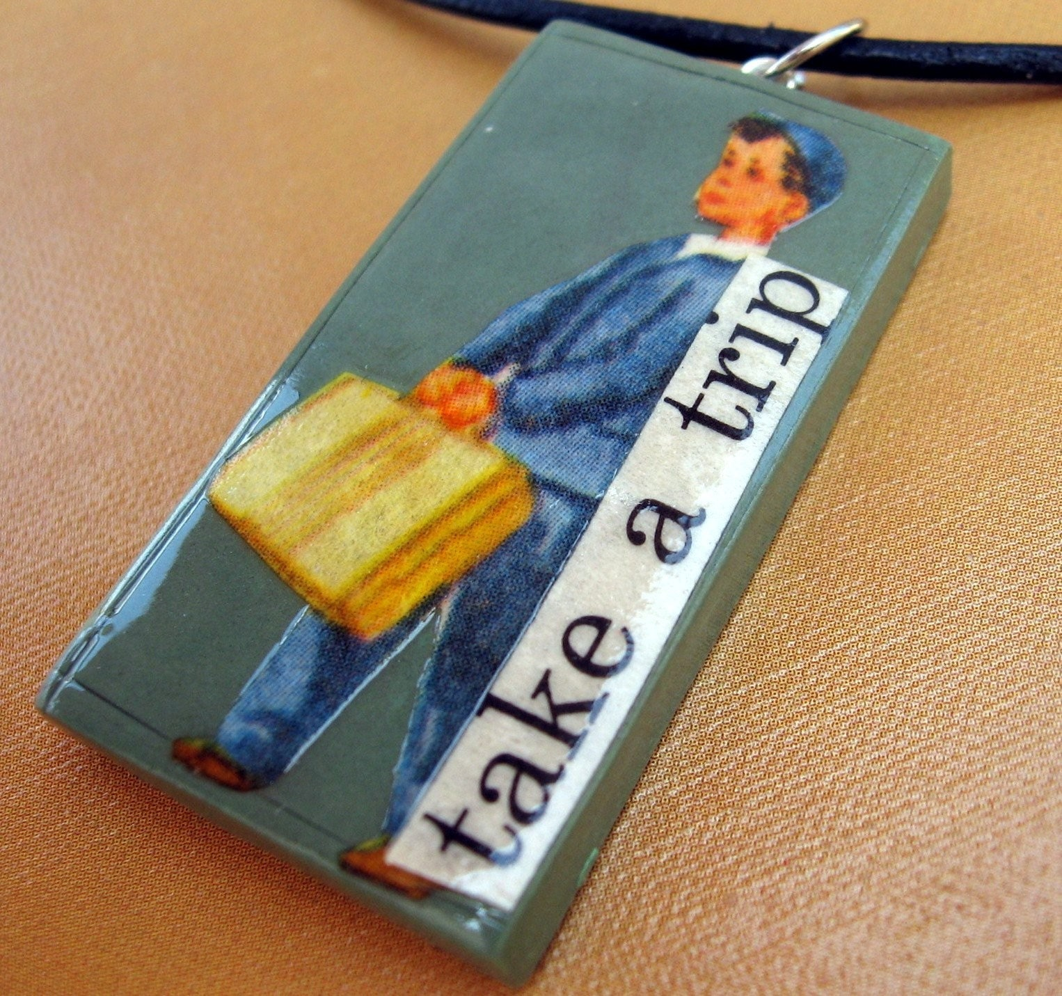 Take a Trip pendant (on leather cord)