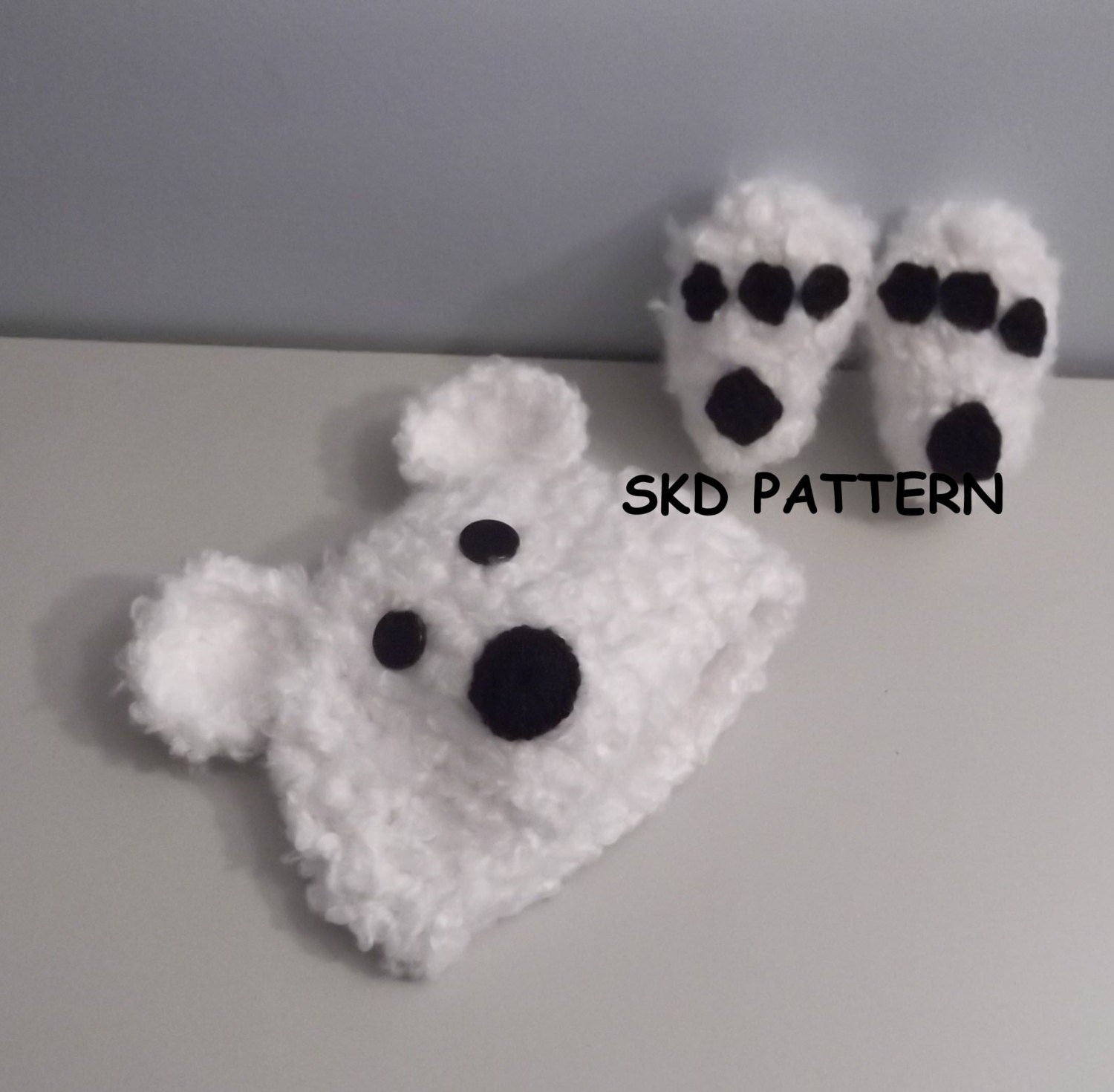 Free Bear Claw Crochet Pattern : Cuddly Soft Polar Bear Hat and Paw Print Booties by ...