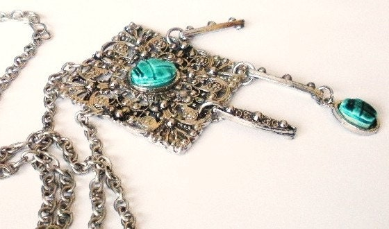 vintage silver pendant with turquoise stones