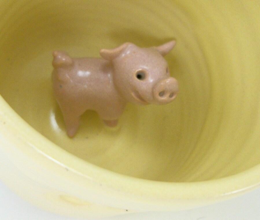yellow mug with a piggy inside