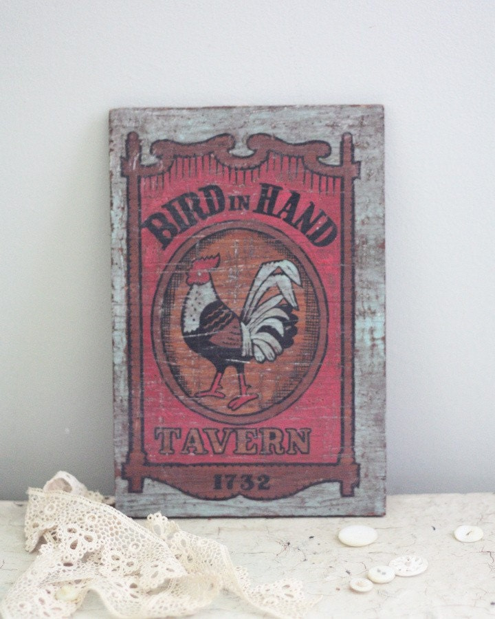 Bird in Hand. Vintage rustic wooden rooster tavern plaque.