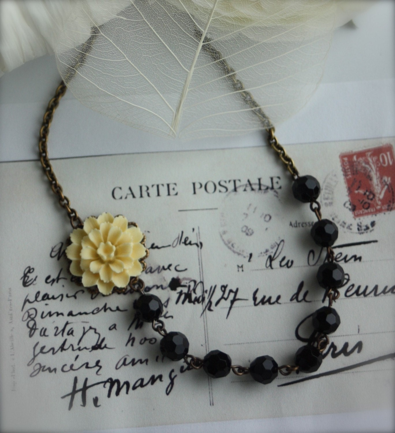 Tabithia. -   Ivory Cream Flower Cabochon, Black Faceted Glass Beads Brass Necklace. Wedding, Garden Inspired