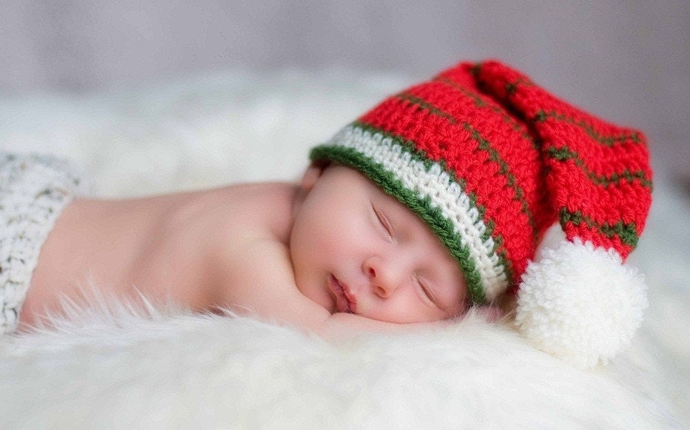 Striped Santa hat with fluffy pom pom. Perfect for photo prop and gift. Sizes 0-12 month