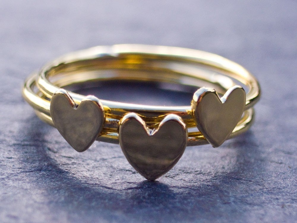 Three tiny heart rings