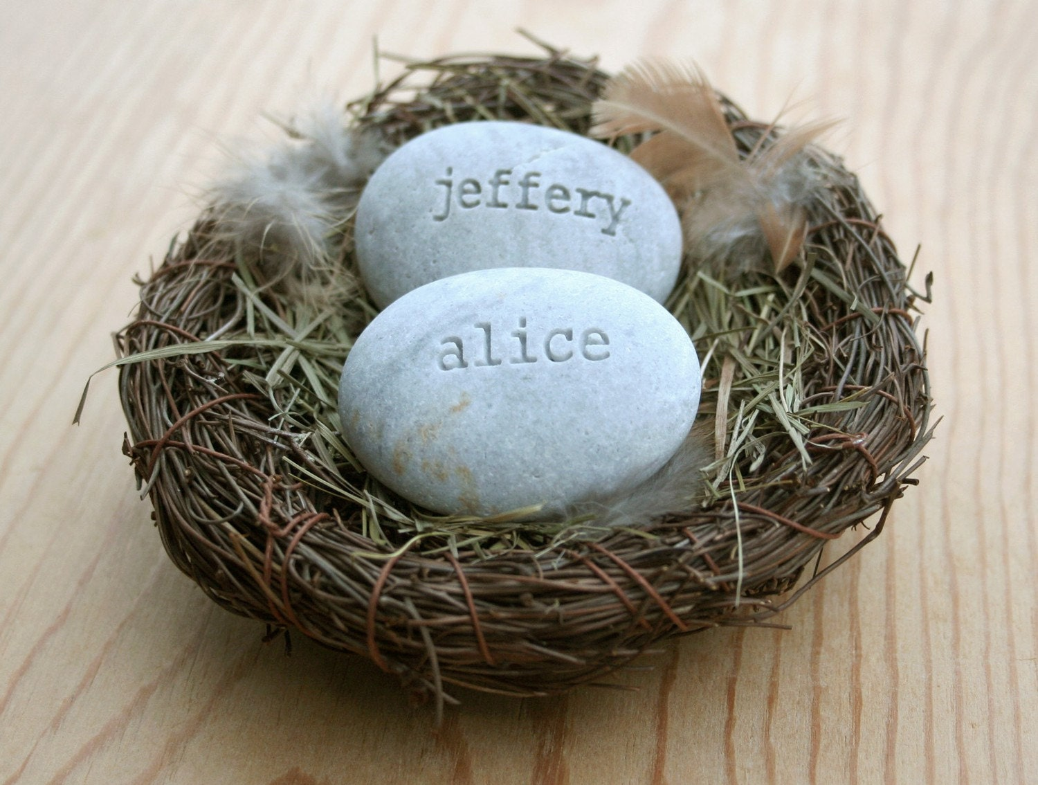 Our nest - custom engraved name stones in nest