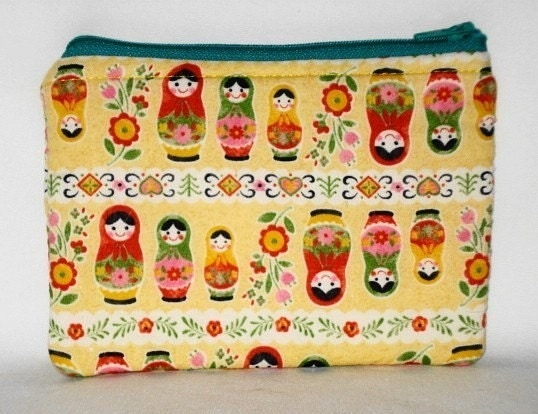 Matryoshkas and Flowers on Yellow  Zippered Pouch Cell by WolfBait from etsy.com