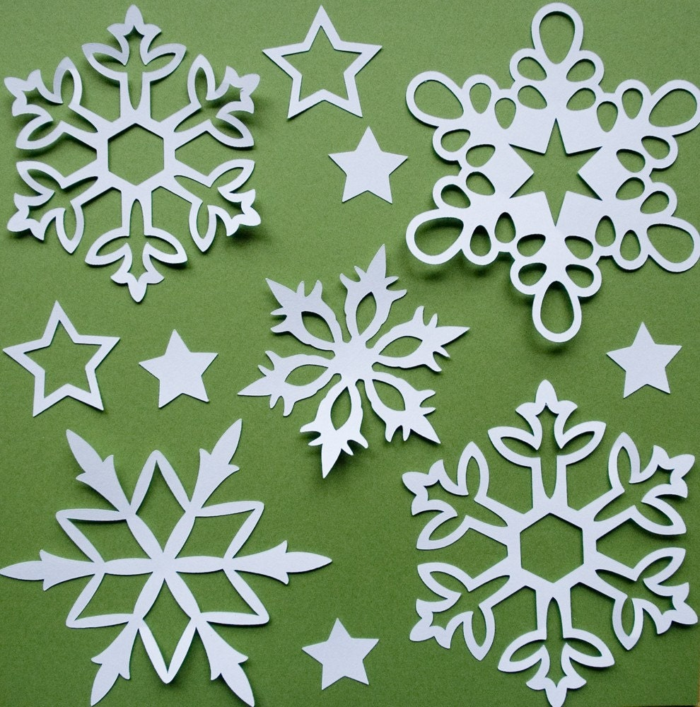 Cut out paper snowflakes (see tutoria l HERE ) Use sharp scissors.