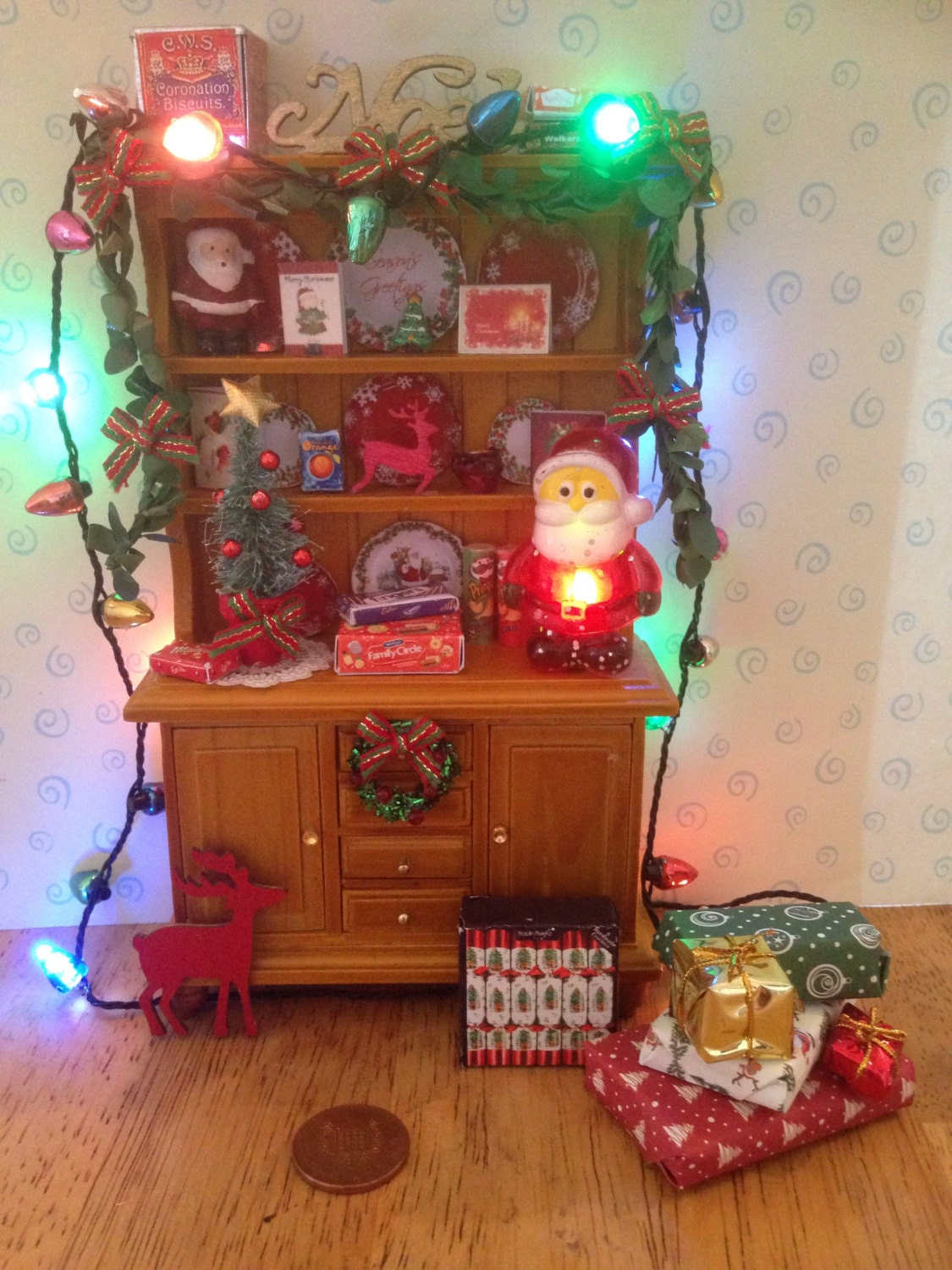 Reduced to clear Dolls house pine dresser unit all decorated for christmas with removable lights flashing santa and all accessories 112