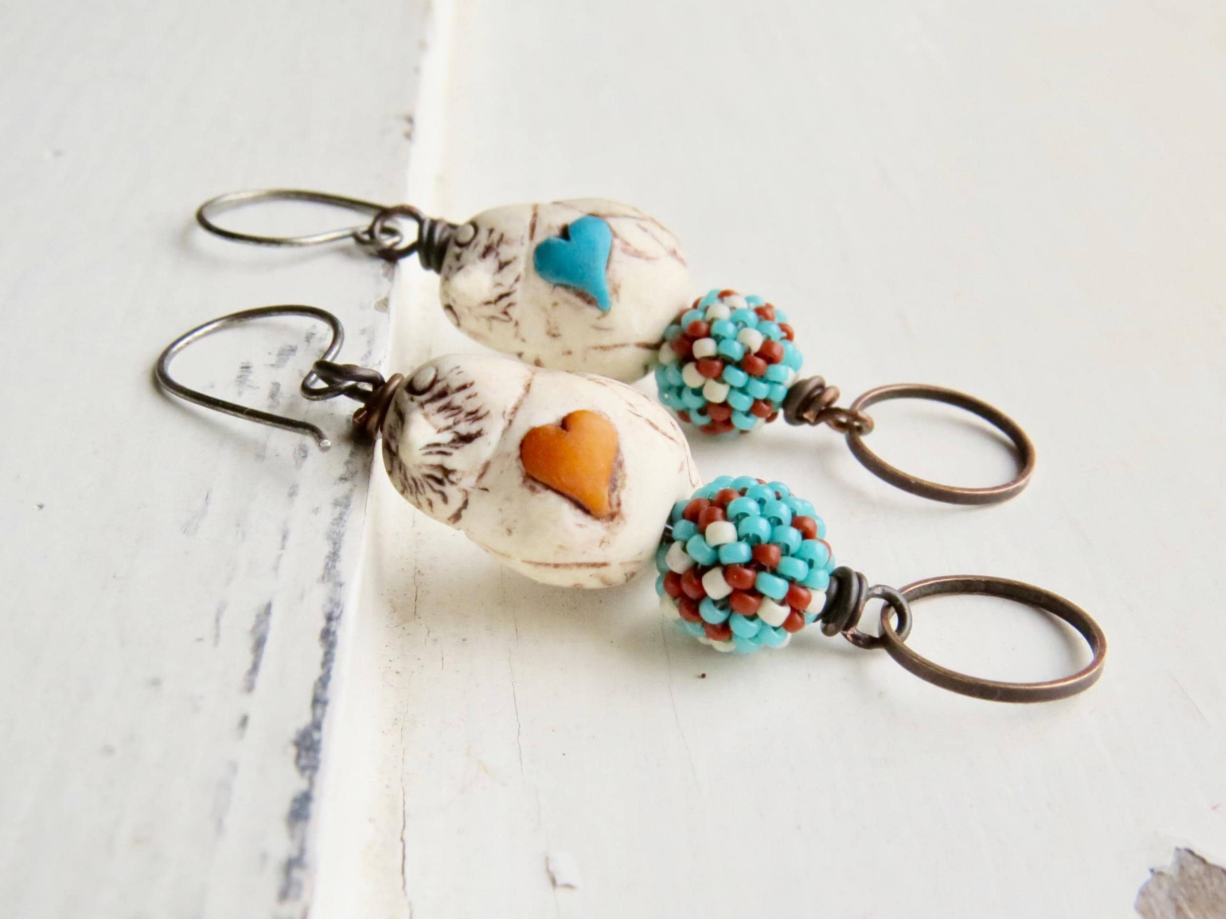 Songbird  subtly mismatched artisanbead bird earrings in aqua orange and cream with polymer and glass beads  Songbead UK narrative