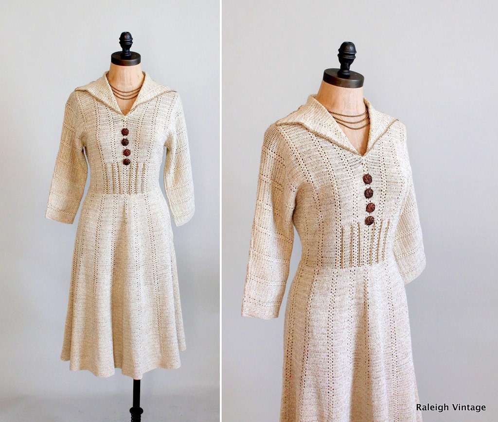1940s crochet knit dress with metallic thread and decorative metal buttons in beige