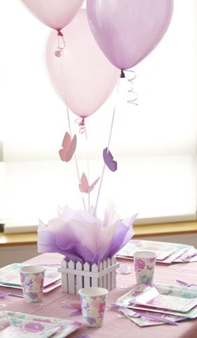 Butterfly centerpieces with personalized table by