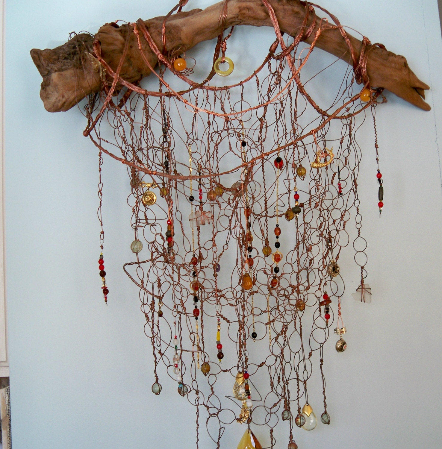 driftwood , amber and  lockets