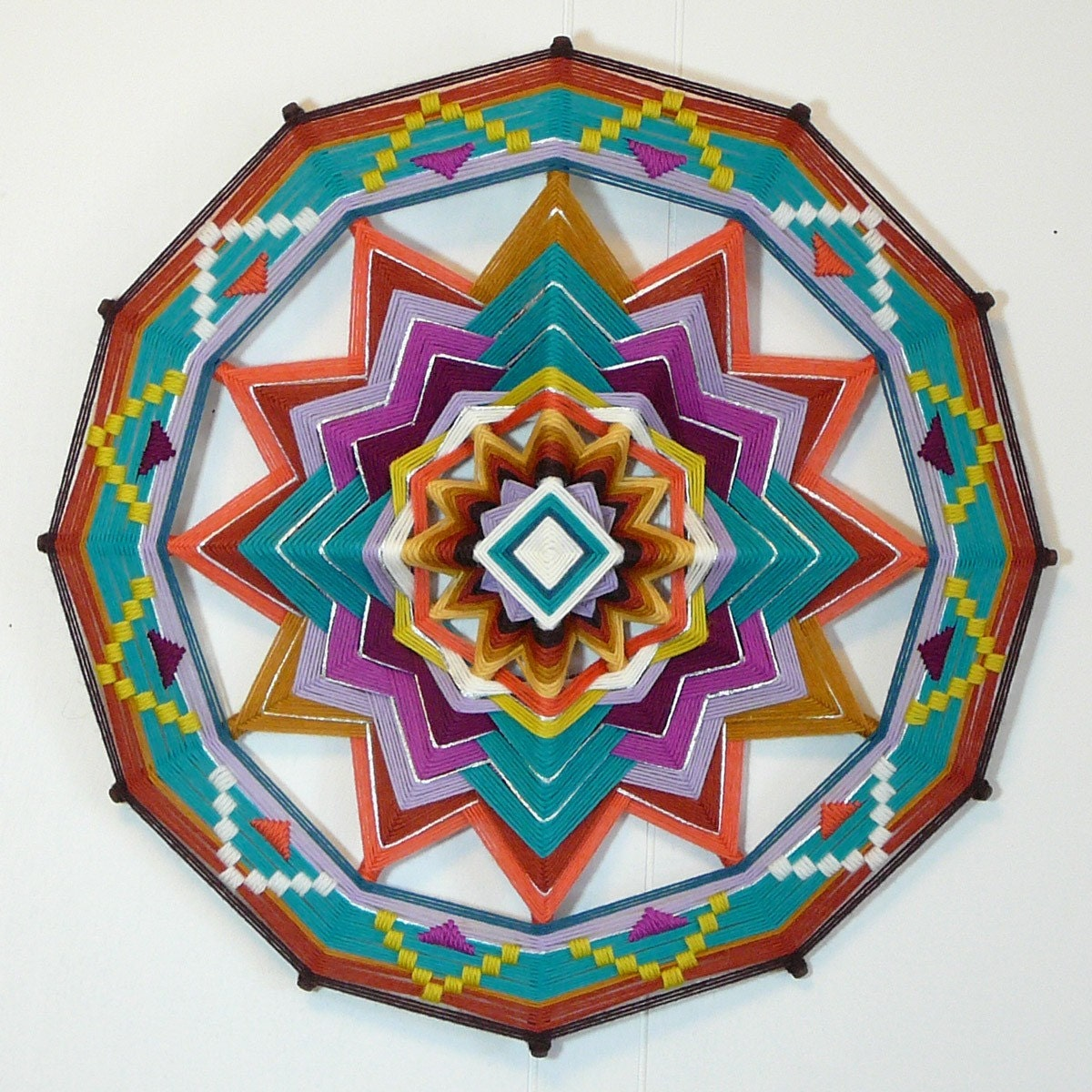 Spirit Reborn, an 18-inch, all wool, Ojo de Dios, by Jay Mohler