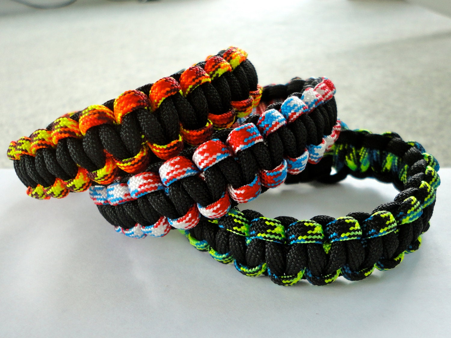 New Paracord Bracelet Pinwheel Seesaw camo red white blue orange blue green black Made in u.s.a.