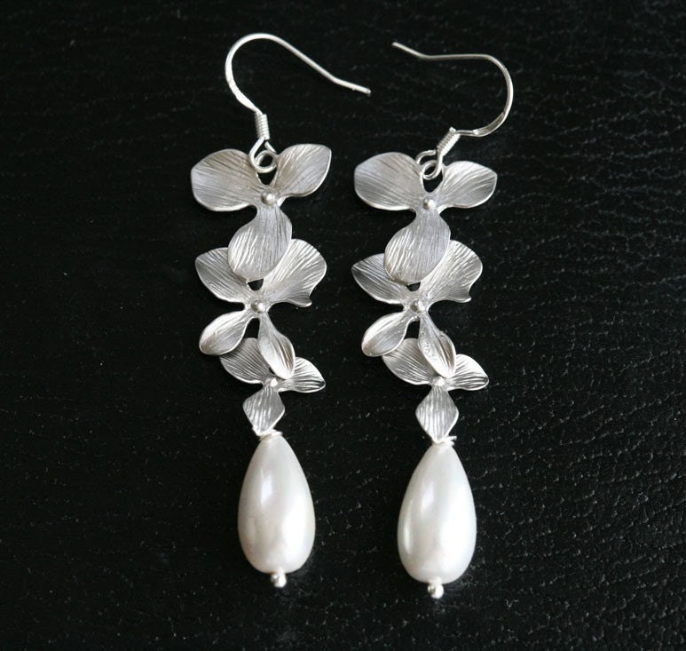 Pretty silver trio orchid flowers and AAA grade shell pearls earring
