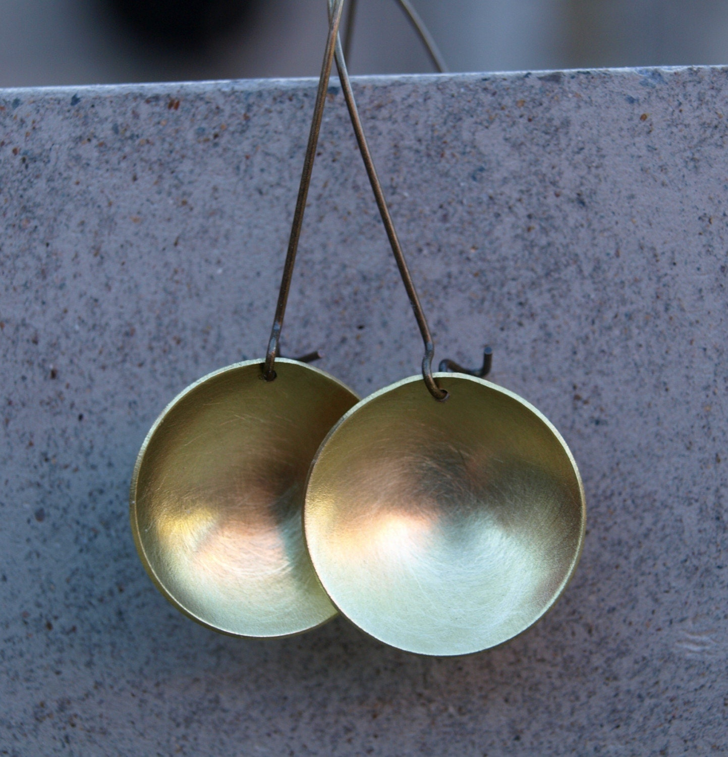Domed brass discs