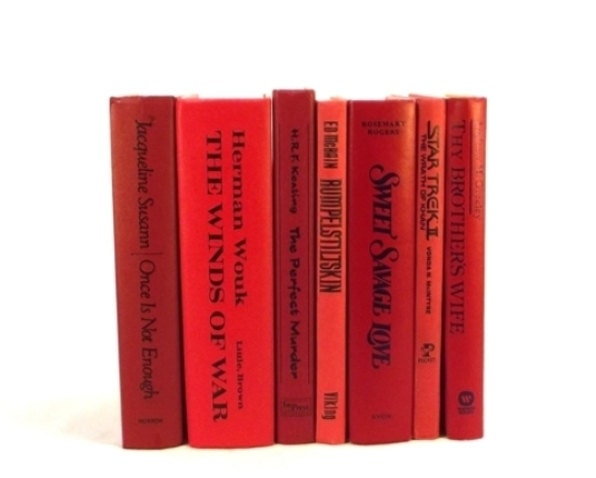 Bright red decorative books table display by - Decorative books for display ...