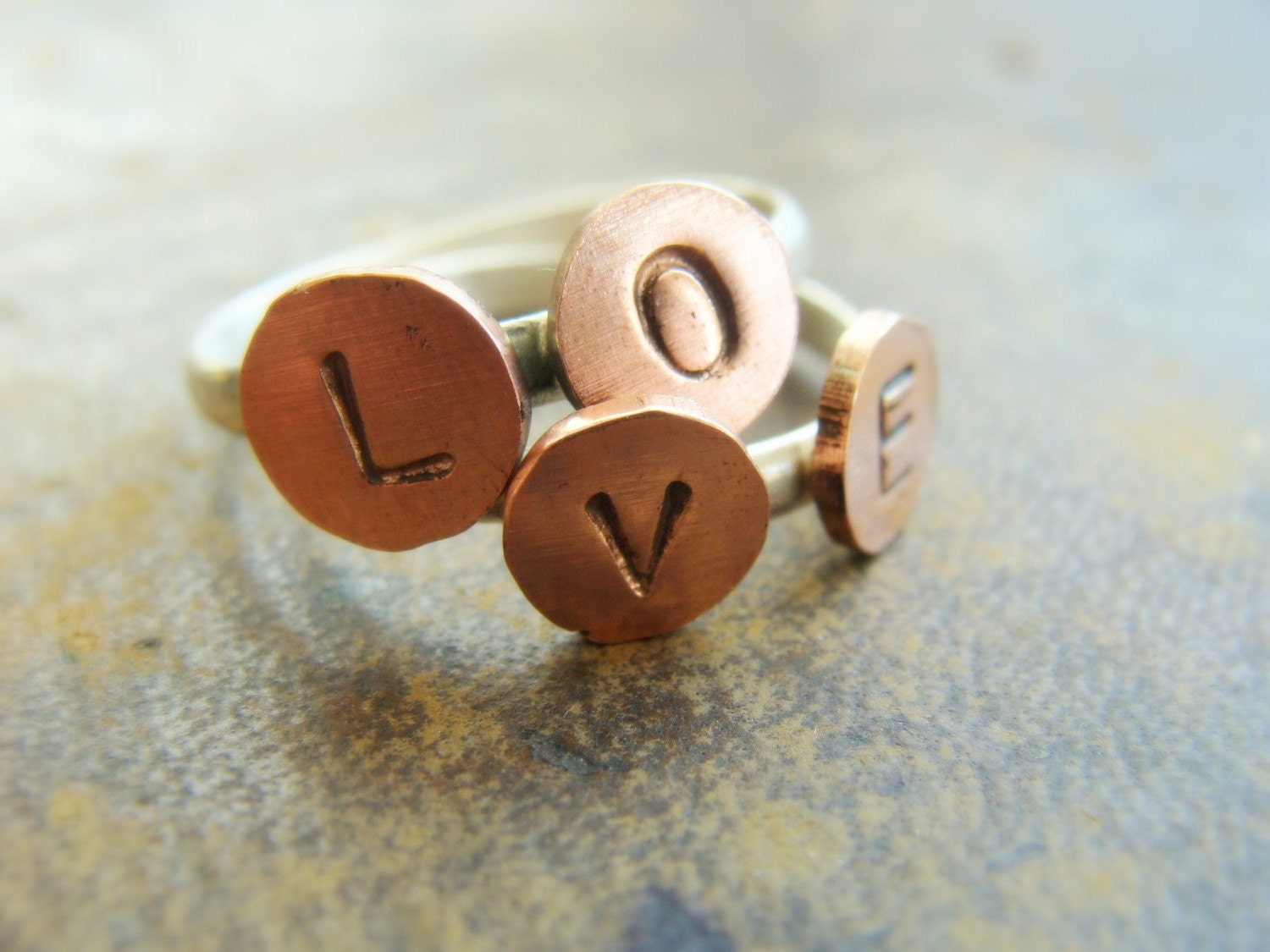 LOVE cooper and silver stamped stack rings