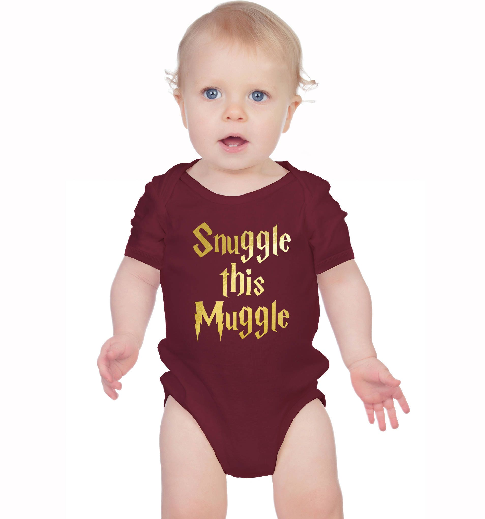 Harry Potter inspired burgundy bodysuit onesie with gold text Snuggle this Muggle.
